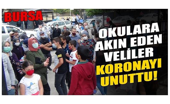 Bursa'da okula akın eden aileler koronavirüsü unuttu