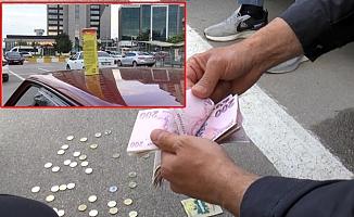 Bursa'da aracının üzerinde para dolu cips kutusu bulan hemşire, polise teslim etti