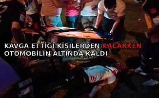 Kavga ettiği kişilerden kaçarken otomobilin altında kalarak yaralandı
