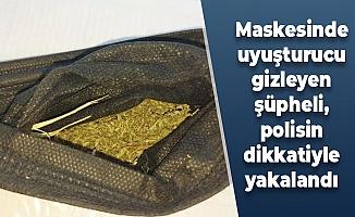 Maskesinde uyuşturucu gizleyen şüpheli, polisin dikkatiyle yakalandı